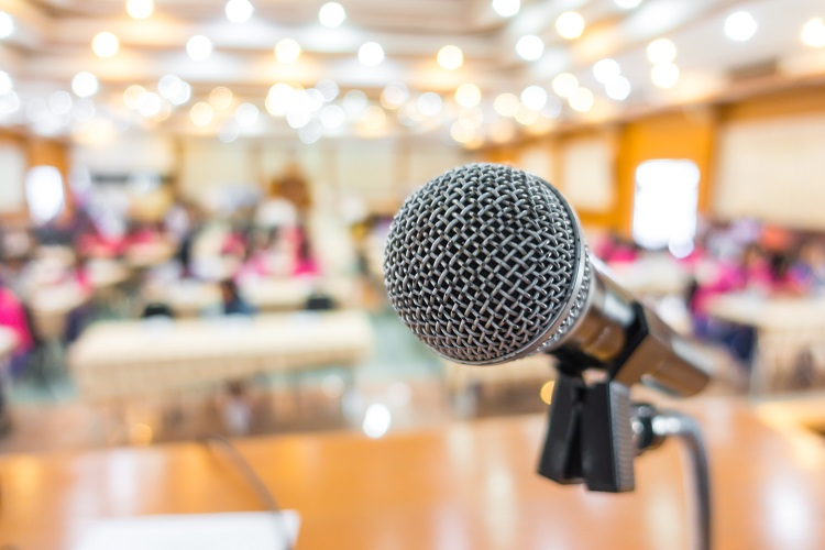 Microphone with a conference room on the background