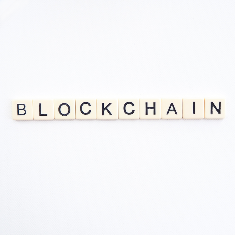 The word blockchain is written with the letters of Scrabble.